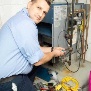 technician installing furnace