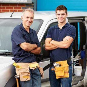 technicians in front of a van