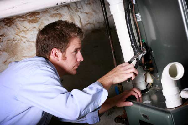 service technician working on furnace